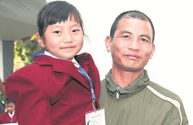 Mhonbeni with her dad in Delhi